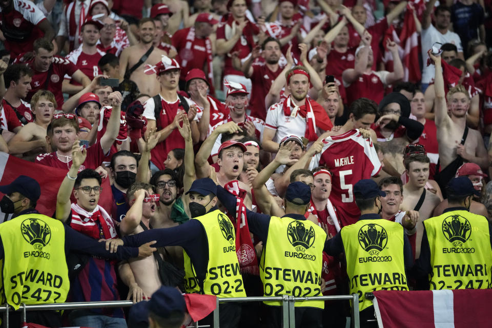 Security watch over Danish fans during the Euro 2020 soccer championship quarterfinal match between Czech Republic and Denmark, at the Olympic stadium in Baku, Saturday, July 3, 2021. (AP Photo/Darko Vojinovic, Pool)