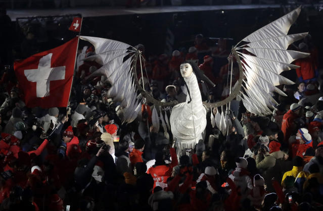 <p>Athletes surround a sculpture during the closing ceremony of the 2018 Winter Olympics in Pyeongchang, South Korea, Sunday, Feb. 25, 2018. (AP Photo/Chris Carlson) </p>