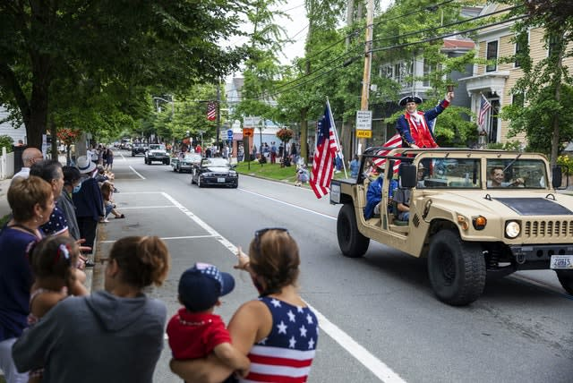 Spectators watch as a Fourth of July parade passes in Bristol, Rhode Island (David Goldman/AP)