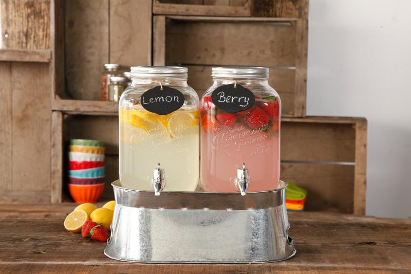 """<p>The set includes two 1-gallon drink dispensers, one ice bucket, two lids, one mini chalk with twine rope board, two chalk pencils and one recipe card. Available at Walmart, <a href=""""http://yahooshopping.pgpartner.com/plr.php?id=18001"""" rel=""""nofollow noopener"""" target=""""_blank"""" data-ylk=""""slk:$28.67"""" class=""""link rapid-noclick-resp"""">$28.67</a>.</p>"""
