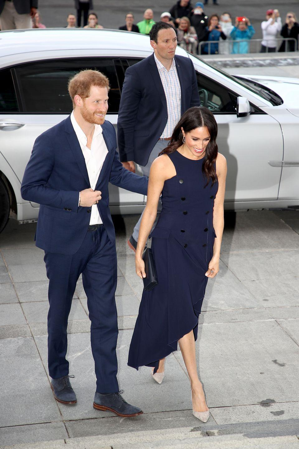 <p>Later in the evening Meghan looked on as Prince Harry gave a speech.</p>