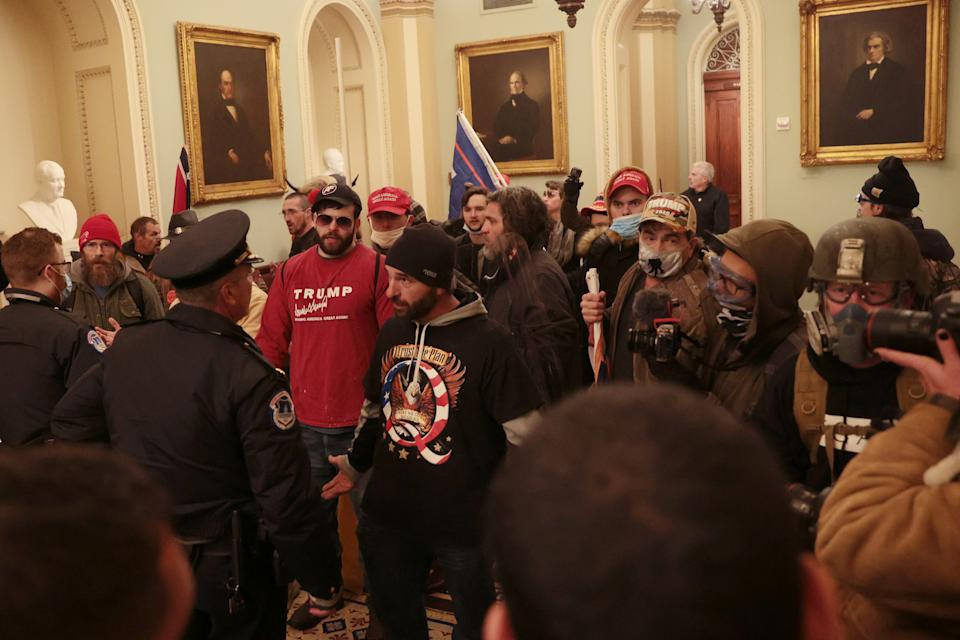 Protesters pictured with Capitol Police inside the US Capitol Building on January 06, 2021 in Washington, DC.