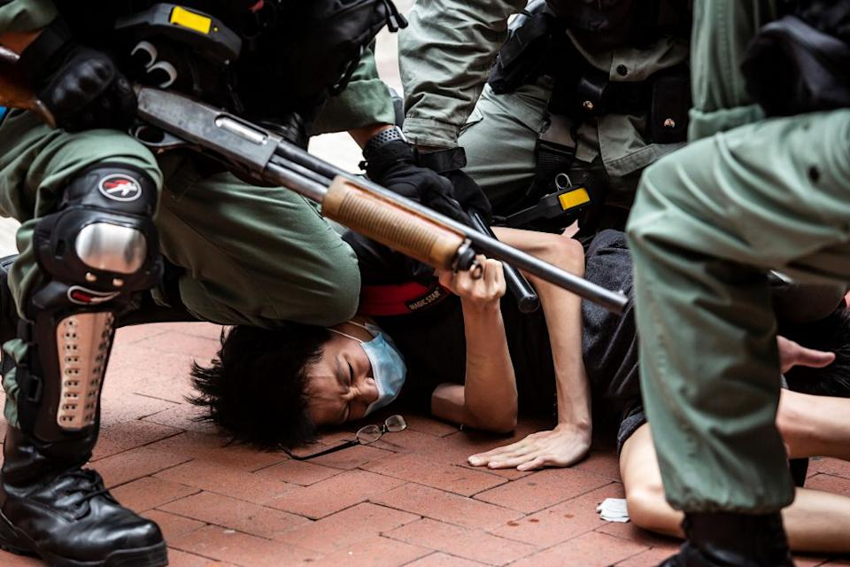 Pro-democracy protesters are arrested by police in the Causeway Bay district of Hong Kong.