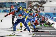 <p>Justine Braisaz, of France, leads the pack away from the shooting positions during the women's 10-kilometer biathlon pursuit at the 2018 Winter Olympics in Pyeongchang, South Korea, Monday, Feb. 12, 2018. (AP Photo/Gregorio Borgia) </p>
