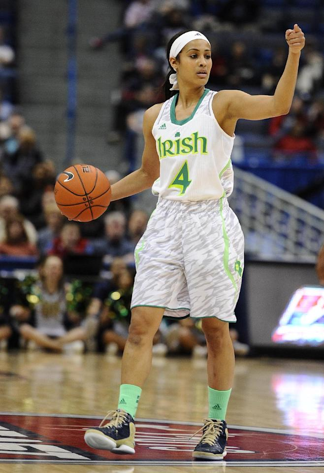 FILE - This March 10, 2013 file photo shows Notre Dame's Skylar Diggins during in the first half of an NCAA college basketball game in the quarterfinals of the Big East Conference women's tournament against South Florida in Hartford, Conn. The neon-colored jerseys and camouflage-covered shorts debuted by six teams in their post-season conference championships ahead of the NCAA men's basketball tournament weren't well received in the press and social media. The changes happened to be in line with fashion runways and in recreational athleticwear, where highlighter brights and creative camo have been bona fide trends, and alternate uniforms have become part of the college football and basketball landscape, but on the court, these uniforms still made fans cringe. (AP Photo/Jessica Hill, file)