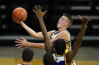 Iowa guard Joe Wieskamp drives to the basket over Western Illinois forward Tamell Pearson during the second half of an NCAA college basketball game, Thursday, Dec. 3, 2020, in Iowa City, Iowa. (AP Photo/Charlie Neibergall)