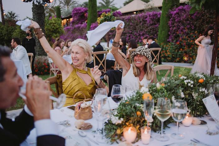 My fun aunts, Federica Formilli Fendi and Giovanna Caruso Fendi, waving their napkins to the music. I loved seeing how much fun the guests had, including the whole family.