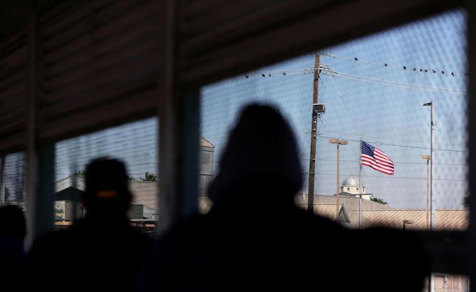 A US flag is pictured at Matamoros-Brownsville international border bridge, as seen from Matamoros, Mexico, on 19 February.