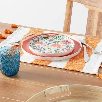 <p>This <span>Cotton Preppy Stripe Placemat</span> ($5) will make a cheerful addition to your kitchen essentials.</p>
