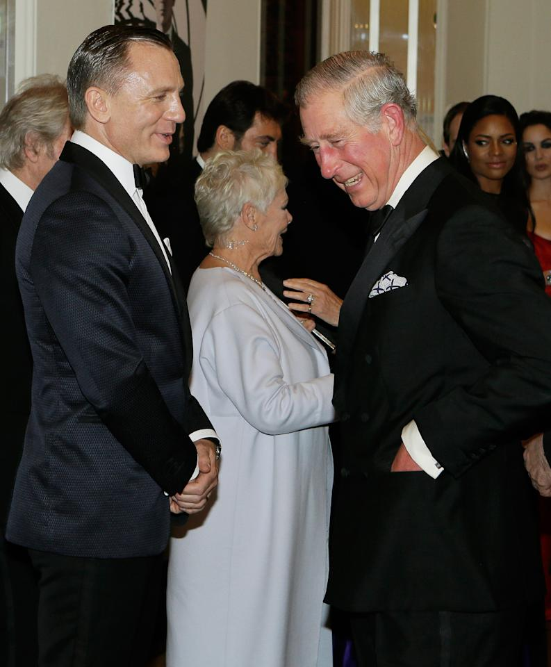 """LONDON, UNITED KINGDOM - OCTOBER 23:  Prince Charles, Prince of Wales meets James Bond actors Daniel Craig and Dame Judi Dench as they arrive for the Royal World Premiere of the James Bond film """"Skyfall"""" at the Royal Albert Hall on October 23, 2012 in London, England.  (Photo by Kirsty Wigglesworth - WPA Pool/Getty Images)"""