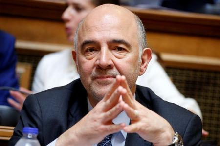 European Economic and Financial Affairs Commissioner Pierre Moscovici attends a parliamentary committee meeting in Athens