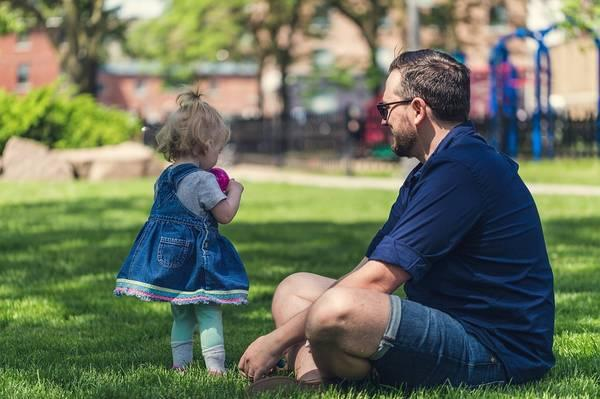 Father and daugher playing