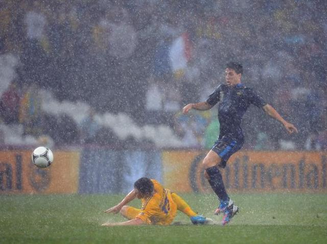TOPSHOTS French midfielder Samir Nasri (R) vies with Ukrainian defender Vyacheslav Shevchuk during the Euro 2012 championships football match Ukraine vs France on June 15, 2012 at the Donbass Arena in Donetsk. AFP PHOTO / PATRICK HERTZOGPATRICK HERTZOG/AFP/GettyImages