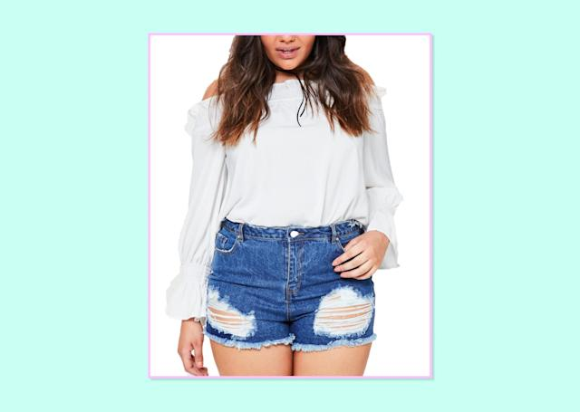 "<p>$56, <a href=""https://www.missguidedus.com/plus-size-blue-high-waist-busted-hem-shorts-10044505-blue"" rel=""nofollow noopener"" target=""_blank"" data-ylk=""slk:Missguided"" class=""link rapid-noclick-resp"">Missguided</a> </p>"