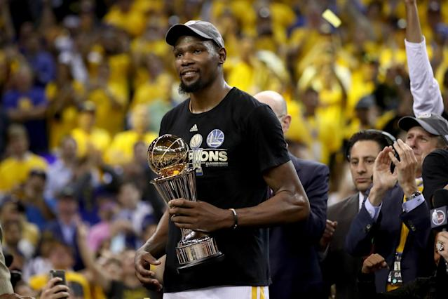 <p>Kevin Durant #35 of the Golden State Warriors celebrates after being named Bill Russell NBA Finals Most Valuable Player after defeating the Cleveland Cavaliers 129-120 in Game 5 to win the 2017 NBA Finals at ORACLE Arena on June 12, 2017 in Oakland, California. </p>