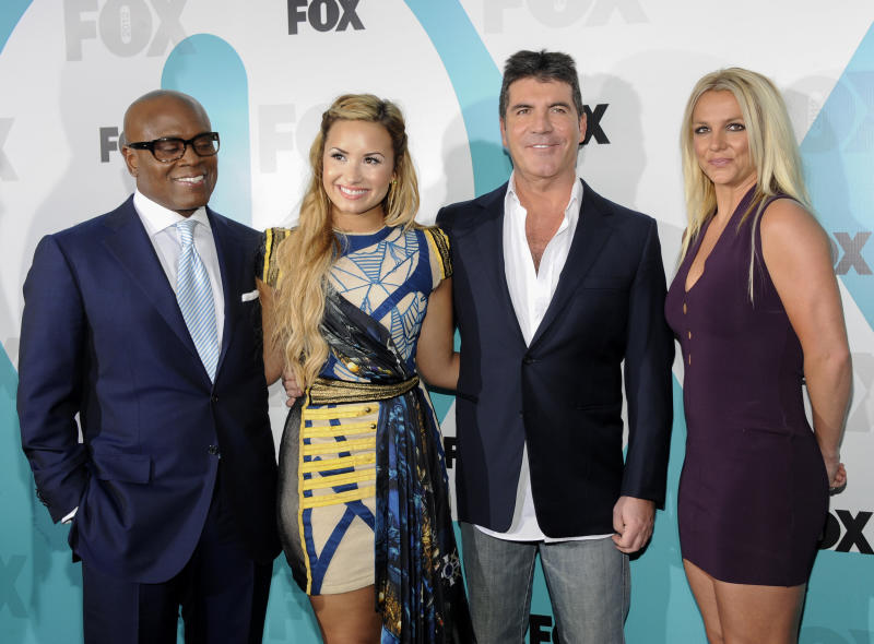 """The X Factor"" judges, from left, L.A. Reid, Demi Lovato, Simon Cowell and Britney Spears attend the FOX network upfront presentation party at Wollman Rink, Monday, May 14, 2012 in New York. (AP Photo/Evan Agostini)"
