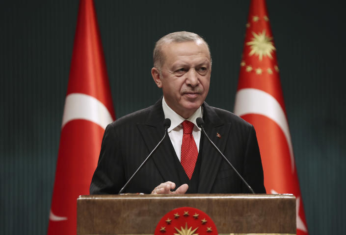 Turkey's President Recep Tayyip Erdogan speaks after a cabinet meeting, in Ankara, Turkey, Monday, Nov. 30, 2020. Erdogan has announced the most widespread lockdown so far amid a surge in COVID-19 infections, extending curfews to weeknights and full lockdowns over weekends.(Turkish Presidency via AP, Pool)