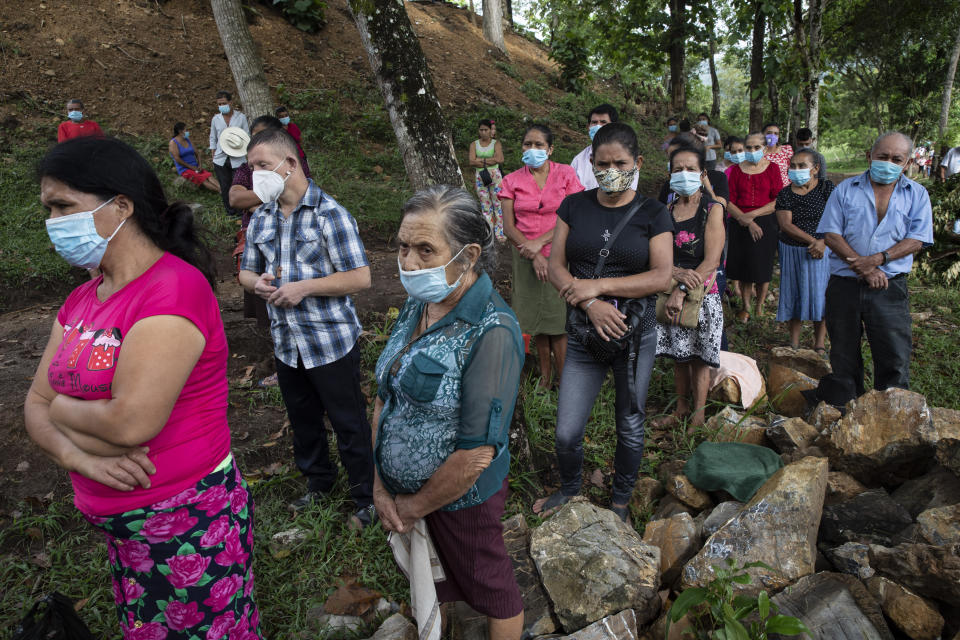La Reina residents left homeless when their community was buried in an epic mudslide triggered by Hurricanes Eta and Iota, attend an outdoor Mass at Mission San Francisco de Asis, Honduras, Sunday, June 27, 2021. It was the the first time in recorded history that successive Category 4 and 5 Atlantic hurricanes slammed the same place. (AP Photo/Rodrigo Abd)