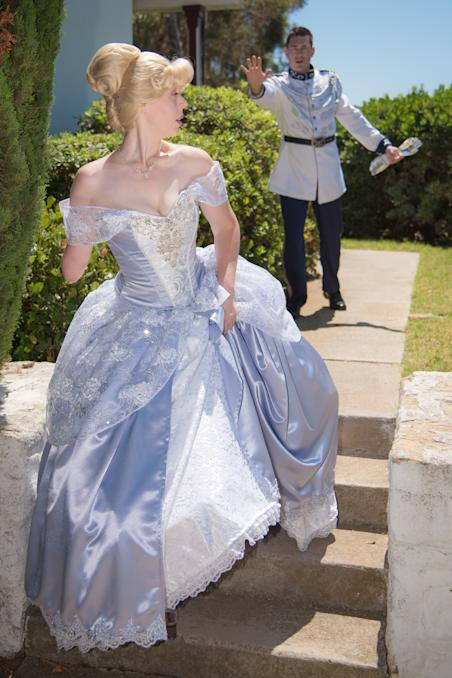 Mandy Pursley as Cinderella while Prince Charming chases her with missing glass arm