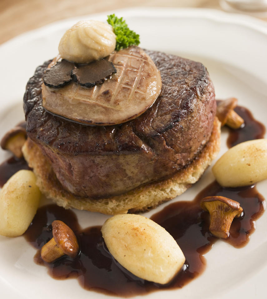 <p>If you want to push the boat out and indulge, Tournedos Rossini is the way to go. Beef fillet, pan-fried in butter and served on top of a crouton (basically fried bread). And then, topped with a slice of pan-fried foie gras. All finished off with a madeira sauce. Yes, that. Indulgence on a plate. [Photo: Getty] </p>