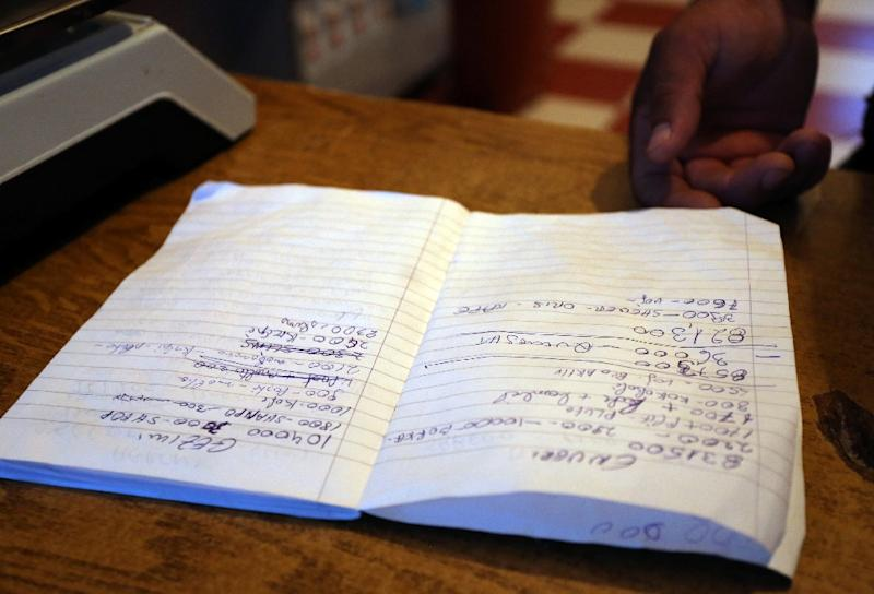A notebook bearing the names of debtors in a store in the Albanian village of Suk, near the city of Fier, on June 29, 2015 (AFP Photo/Gent Shkullaku)
