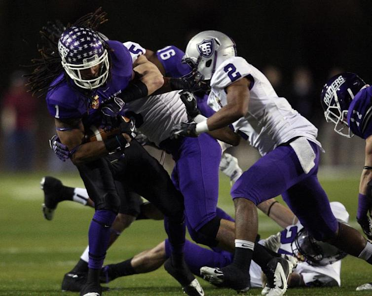 Mount Union's Chris Denton (1) is tackled by St. Thomas' Pat Flaherty (5) and Chinni Oji (2), right, during the first half of the NCAA Division III football championship in Salem, Va., Friday, Dec. 14, 2012. (AP Photo / The Roanoke Times, Daniel Lin) LOCAL TV OUT; LOCAL INTERNET OUT; LOCAL PRINT OUT (SALEM TIMES REGISTER; FINCASTLE HERALD; CHRISTIANSBURG NEWS MESSENGER; RADFORD NEWS JOURNAL; ROANOKE STAR SENTINEL