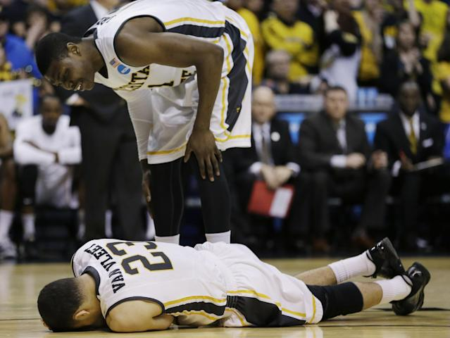 Wichita State forward Cleanthony Early (11) checks on guard Fred VanVleet (23) during the second half of a third-round game against Kentucky at the NCAA college basketball tournament Sunday, March 23, 2014, in St. Louis. (AP Photo/Jeff Roberson)