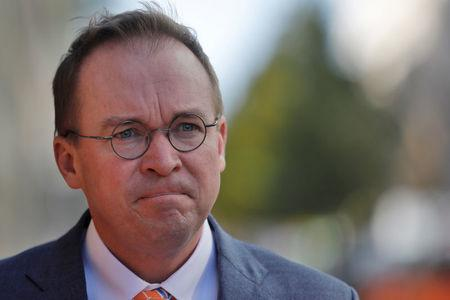 Office of Management and Budget Director Mulvaney leaves the Consumer Financial Protection Bureau building after a meeting in downtown Washington D.C.