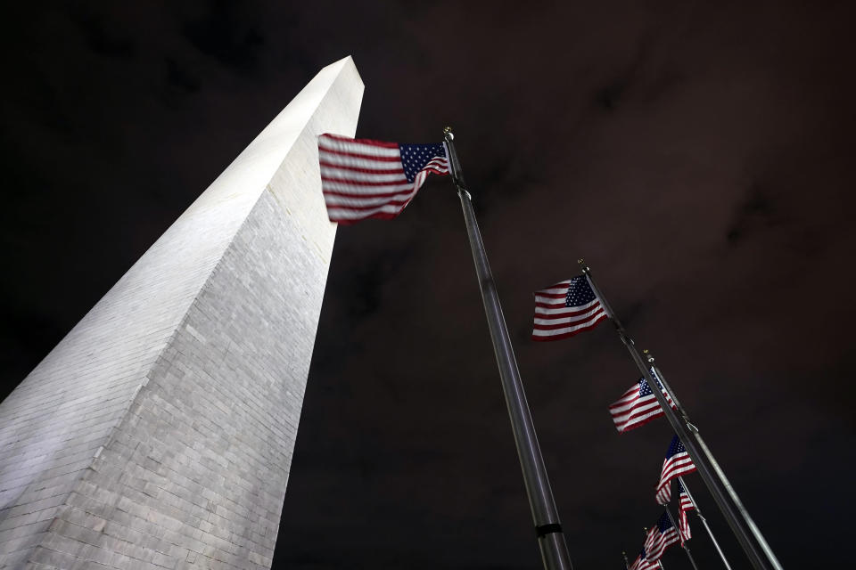 American flags fly around the Washington Monument Friday, Dec. 18, 2020, in Washington. The Trump administration has closed the Washington Monument because of a recent visit by Interior Secretary David Bernhardt, who tested positive this week for the coronavirus. Interior spokesman Nicholas Goodwin says a couple monument workers were quarantining as a result of Bernhardt's visit, forcing a staffing shortage and the monument's closure. (AP Photo/Manuel Balce Ceneta)