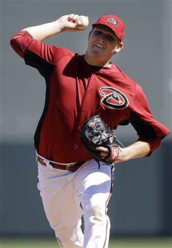 Arizona Diamondbacks starting pitcher Trevor Cahill throws to the Los Angeles Angels during the second inning of a spring training baseball game Tuesday, March 13, 2012 in Scottsdale, Ariz. (AP Photo/Marcio Jose Sanchez)