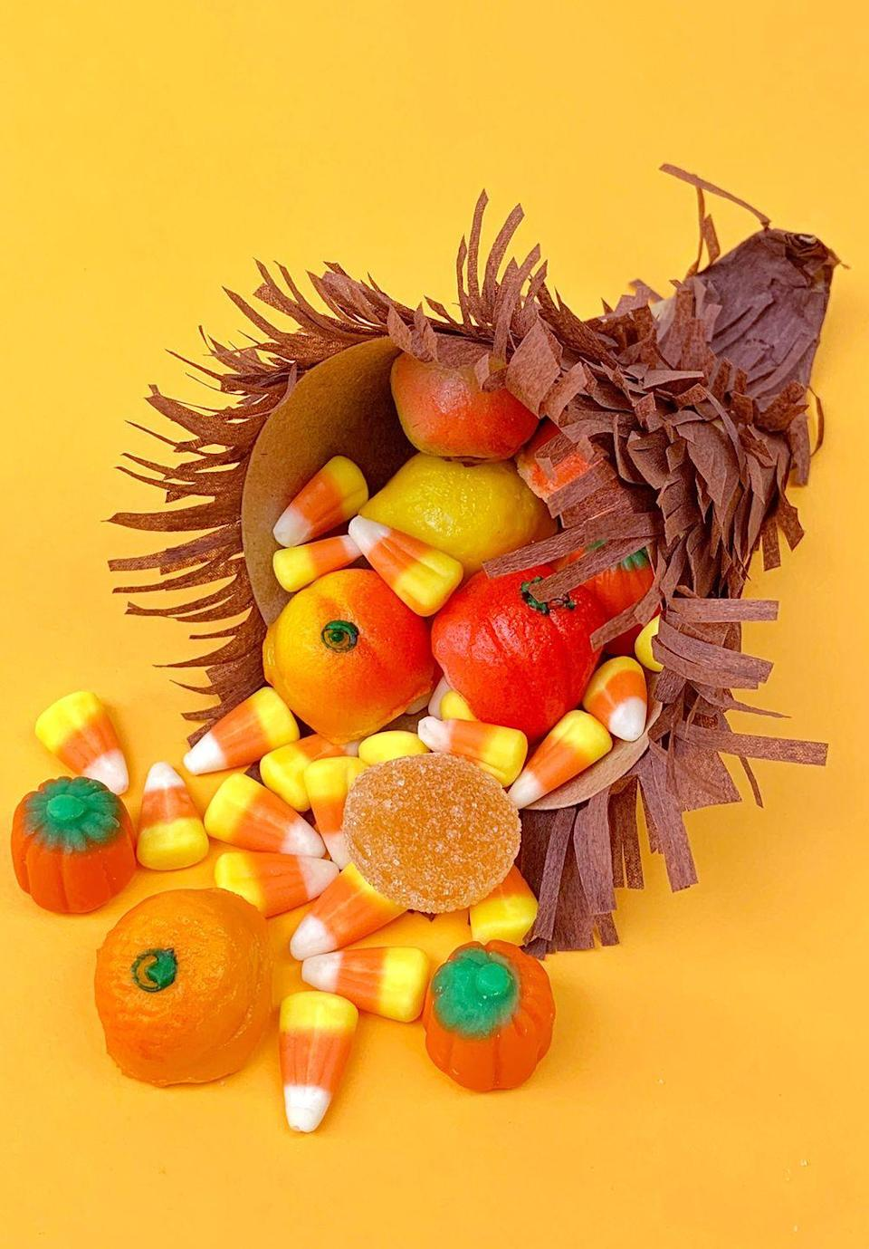 """<p>Typically, cornucopia are stuffed with an assortment of fresh fruits and veggies. On one of the best holidays of the year? Sweets take over. </p><p><em><a href=""""https://www.happinessishomemade.net/candy-cornucopia-thanksgiving-craft/"""" rel=""""nofollow noopener"""" target=""""_blank"""" data-ylk=""""slk:Get the tutorial from Happiness Is Homemade »"""" class=""""link rapid-noclick-resp"""">Get the tutorial from Happiness Is Homemade »</a></em></p>"""