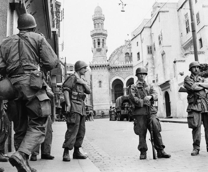 FILE - In this May 27, 1956 file photo, French troops seal off Algiers' notorious casbah, 400-year-old teeming Arab quarter. French President Emmanuel Macron has met with four grandchildren of an Algerian independence fighter to tell them that Ali Boumendjel had been tortured and assassinated at the hands of French soldiers in 1957, taking another step in his effort at reconciling France with its colonial past and offering anew an outstretched hand to Algeria, France's crown jewel in 132 years of occupation. (AP Photo, File)