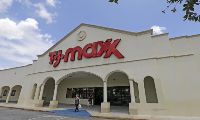 TJ Maxx's parent company will be among the notable companies reporting earnings on Tuesday. (AP Photo/Alan Diaz)