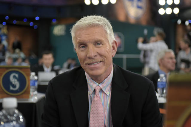 FILE - In this June 8, 2015, file photo, former Philadelphia Phillies third baseman Mike Schmidt poses for a photo as he represents the Phillies at the baseball draft in Secaucus, N.J. The Phillies selected Schmidt in 1971 with the 30 pick overall, in the second round of the draft. (AP Photo/Bill Kostroun, File)