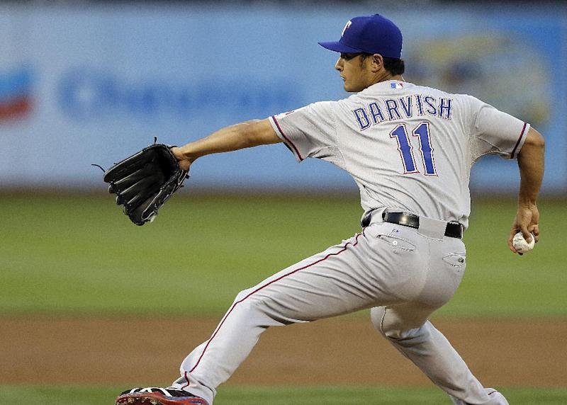 Texas Rangers' Yu Darvish of Japan works against the Oakland Athletics in the first inning of a baseball game Monday, April 21, 2014, in Oakland, Calif. (AP Photo/Ben Margot)