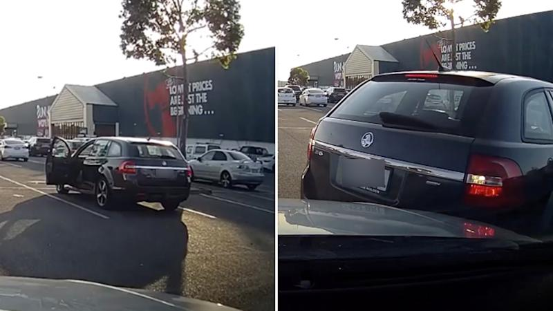 A Holden is seen in the Bunnings Parafield car park on the left. It then appears to hit another vehicle while reversing on the right.