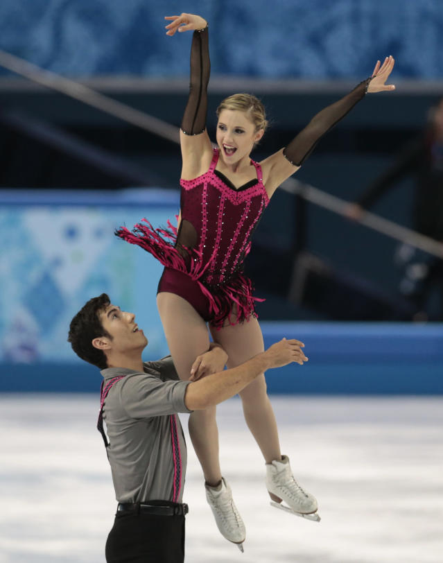Paige Lawrence and Rudi Swiegers of Canada compete in the pairs short program figure skating competition at the Iceberg Skating Palace during the 2014 Winter Olympics, Tuesday, Feb. 11, 2014, in Sochi, Russia. (AP Photo/Ivan Sekretarev)