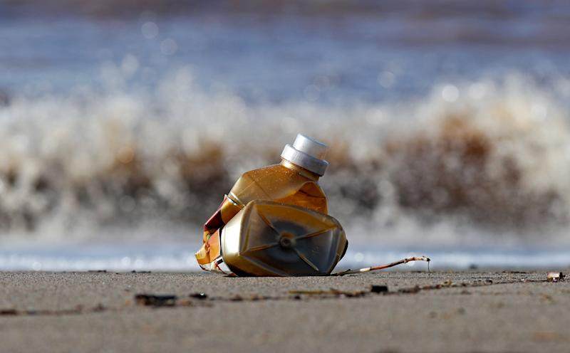 A plastic bottle lies on the sand at Maccarese beach in Rome, Italy. (Photo: Max Rossi/Reuters)