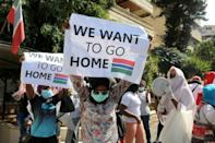 Gambian workers in Lebanon protest at their consulate pleading to be taken home