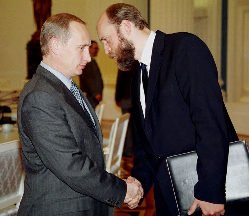 FILE PHOTO: Russian President Vladimir Putin speaks with Sergei Pugachev in Moscow
