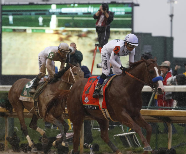 Justify (R) won't have to deal with third-place finisher at the Kentucky Derby, Audible (L), in his bid for the Triple Crown at Belmont. (AP)