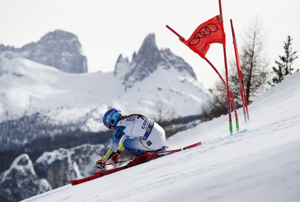 United States' Mikaela Shiffrin speeds down the course during a women's giant slalom, at the alpine ski World Championships in Cortina d'Ampezzo, Italy, Thursday, Feb. 18, 2021. (AP Photo/Gabriele Facciotti)