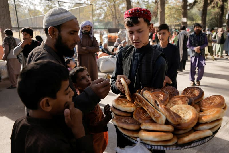 FILE PHOTO: Displaced Afghan families, who flee the violence in their provinces, at a makeshift shelter in Kabul
