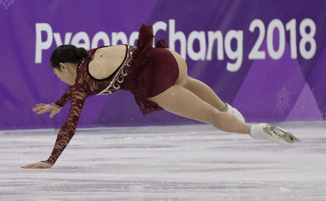Mirai Nagasu of the United States falls during the women's short program figure skating in the Gangneung Ice Arena. (AP)