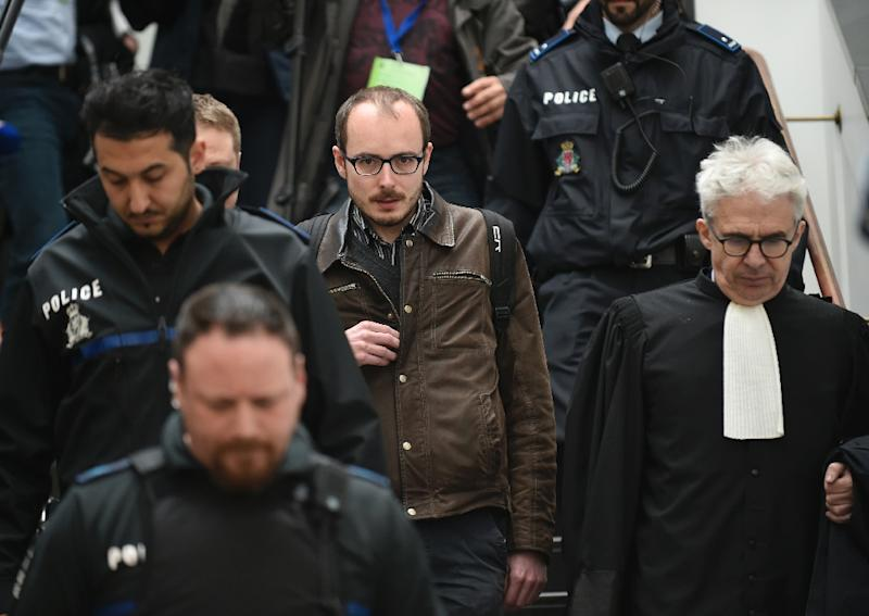 Former employee at services firm PwC Antoine Deltour (C) and his lawyer William Bourdon (R) leave the courthouse in Luxembourg, in April 2016, during a trial over the so-called LuxLeaks scandal
