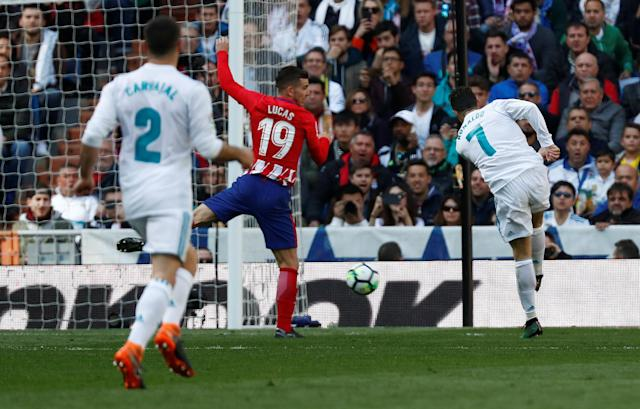 Cristiano Ronaldo scores the first goal of the Madrid Derby with a back-post volley. The game between Real Madrid and Atletico Madrid ended 1-1. (Reuters)