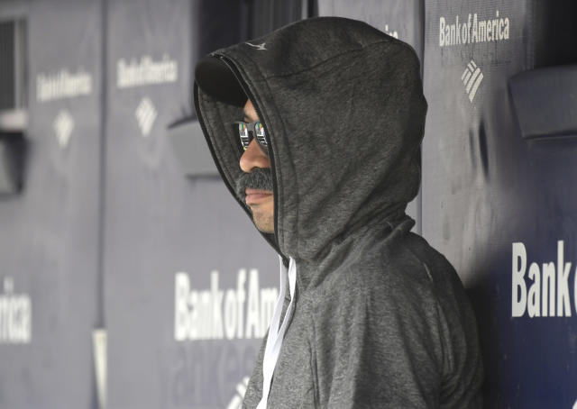 Ichiro Suzuki, special assistant to the chairman of the Seattle Mariners, wears a fake mustache and a hoodie as he sits in the dugout and watches the New York Yankees bat during the first inning of a baseball game Thursday, June 21, 2018, at Yankee Stadium in New York. Suzuki donned a Bobby Valentine-style disguise and sneaked into the Seattle dugout to watch a bit of the action at Yankee Stadium. (AP Photo/Bill Kostroun)