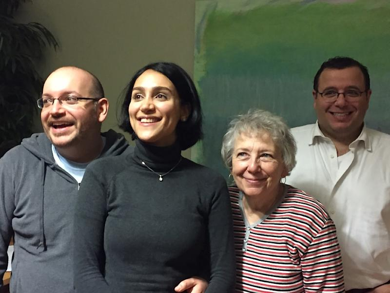 In this January 18, 2016 Washington Post photo former Iranian prisoner Jason Rezaian (L) poses with his wife Yeganeh Salehi (2ndL), mother Mary Rezaian and brother Ali Rezaian (R) (AFP Photo/Martin Baron)