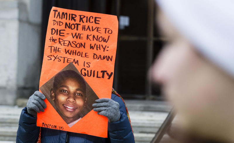 An unidentified woman protests the death of 12-year-old Tamir Rice in Cleveland.