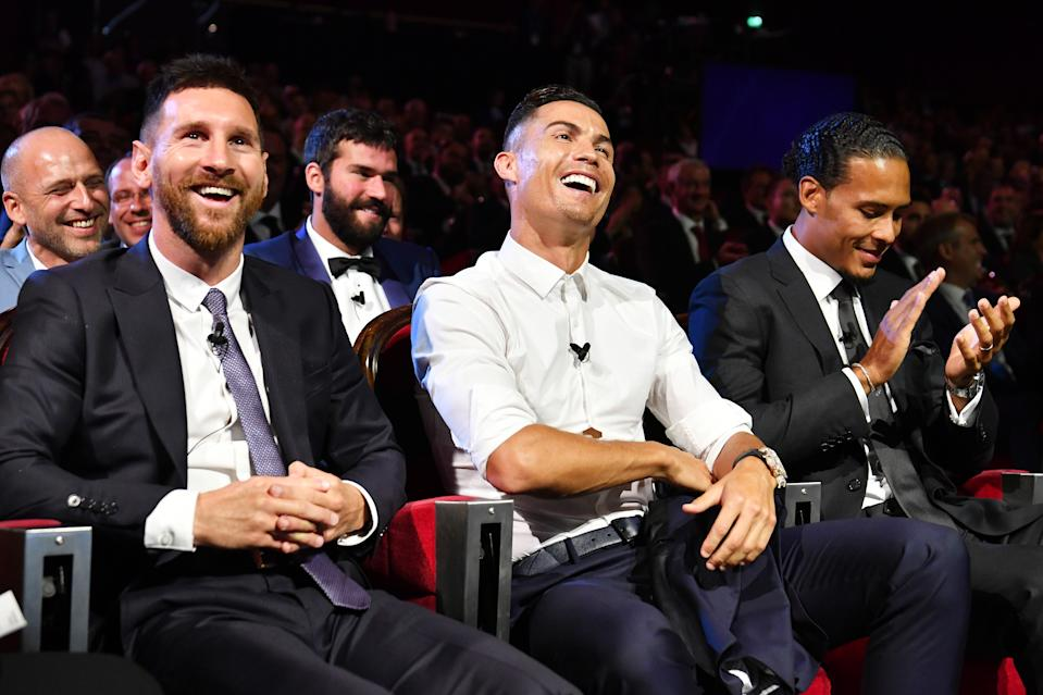 MONACO, MONACO - AUGUST 29: Cristiano Ronaldo of Juventus, Lionel Messi of FC Barcelona and Virgil Van Dijk of Liverpool react during the UEFA Champions League Draw, part of the UEFA European Club Football Season Kick-Off 2019/2020 at Salle des Princes, Grimaldi Forum on August 29, 2019 in Monaco, Monaco. (Photo by Harold Cunningham - UEFA/UEFA via Getty Images)